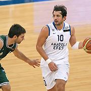 Anadolu Efes's Kerem TUNCERI (R) during their Turkish Basketball League match Anadolu Efes between Aliaga Petkim at Aliaga Arena in Istanbul, Turkey, Sunday, October 23, 2011. Photo by TURKPIX