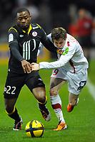 FOOTBALL - FRENCH CHAMPIONSHIP 2010/2011 - L1 - STADE BRESTOIS v LILLE OSC - 19/03/2011 - PHOTO PASCAL ALLEE / DPPI - AURELIEN CHEDJOU FONGANG (LILLE) / BENOIT LESOIMIER (BREST)