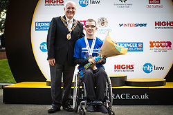 © Licensed to London News Pictures . 15/10/2017 . Manchester , UK . Winner of the wheelchair race ADAM GOLDSPINK-BURGESS accepts his trophy at the end of the Greater Manchester Half Marathon in Old Trafford . Photo credit : Joel Goodman/LNP