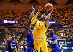 Feb 12, 2020; Morgantown, West Virginia, USA; West Virginia Mountaineers forward Derek Culver (1) shoots in the lane and defended by Kansas Jayhawks center Udoka Azubuike (35) during the second half at WVU Coliseum. Mandatory Credit: Ben Queen-USA TODAY Sports
