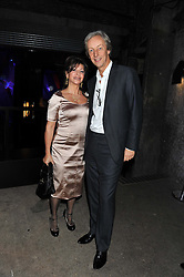 PERRY OOSTING President of Vertu and his wife YELENA at a party to celebrate the launch of the new Vertu Constellation phone - the luxury phonemakers first touchscreen handset, held at the Farmiloe Building, St.John Street, Clarkenwell, London on 24th November 2011.
