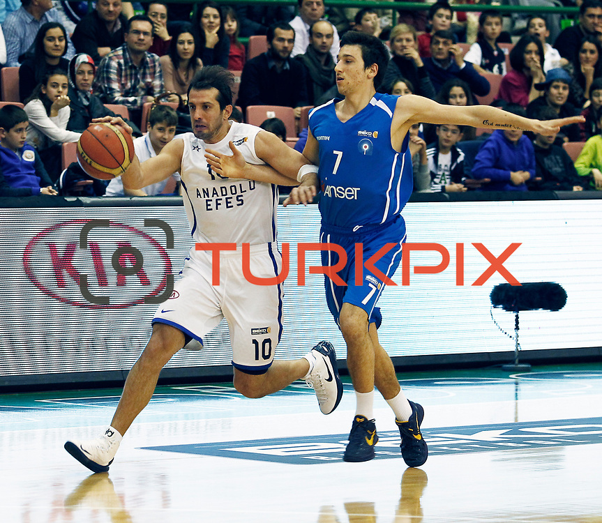 Anadolu Efes's Kerem Tunceri (L) and Antalya BSB's Berkay Gulek (R) during their Turkish Basketball League match Anadolu Efes between Antalya BSB at the Ayhan Sahenk Erdem Arena in Istanbul, Turkey, Sunday, February 24, 2013. Photo by Aykut AKICI/TURKPIX