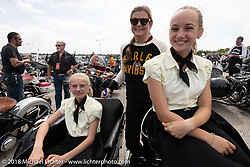 Cris Simmons with Valla and Olive Fritz of Big Bend, WI with their Dad's restored 1956 Harley-Davidson Panhead and sidecar in the staging area for 6,000 plus bikes for the big parade downtown during the Harley-Davidson 115th Anniversary Celebration event. Milwaukee, WI. USA. Sunday September 2, 2018. Photography ©2018 Michael Lichter.Harley-Davidson 115th Anniversary Celebration event. Milwaukee, WI. USA. Sunday September 2, 2018. Photography ©2018 Michael Lichter.