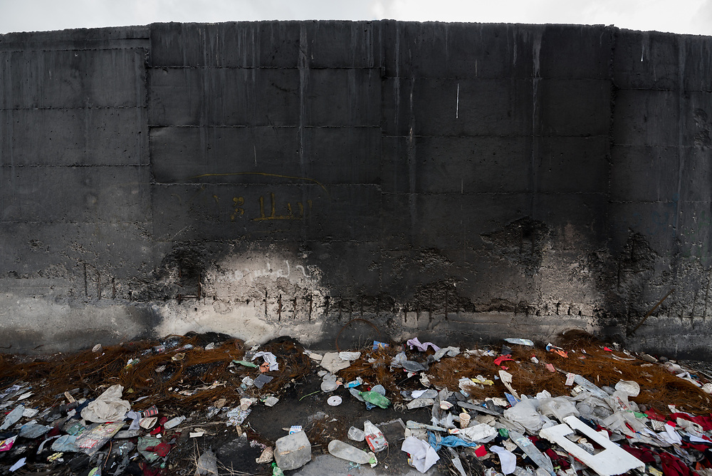 26 February 2020, Abu Dis, Palestine: The separation wall, blackened by ashes, as people have been burning trash in front of it. The separation wall runs through Abu Dis, closing it off from nearby Al-Shikhsa'ad.