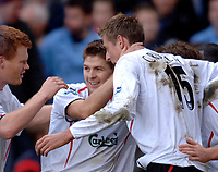 Photo: Glyn Thomas.<br />Aston Villa v Liverpool. The Barclays Premiership. <br />05/11/2005.<br />Liverpool's Steven Gerrard (C) is congratulated by teammates after scoring from the penalty spot.