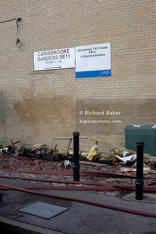 Roofing debris lies on the pavements from nearby flats after an inner-city fire in London. About 310 people were forced to leave their homes after the fire engulfed a wooden structure under construction in scaffolding at Sumner Road and Garrisbrooke Estate, Peckham, London at about 0430 AM. It spread to two blocks of maisonettes and a destroyed a pub. More than 150 firefighters tackled this unusually large and ferocious fire which injured ten people, including two police officers who received hospital treatment for minor injuries.  .