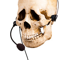 Sad Skull and headset. Bad customer service.