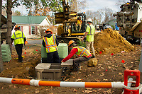 Mirra Contractors install the conduit system for Comcast cable in Briarcrest Estates on Wednesday.  (Karen Bobotas Photo/for The Laconia Daily Sun)