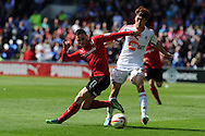 Cardiff city's Craig Conway (l) is challenged by Bolton's Chung- Yong Lee. NPower championship, Cardiff city v Bolton Wanderers at the Cardiff city Stadium in Cardiff, South Wales on Saturday 27th April 2013. pic by Andrew Orchard,  Andrew Orchard sports photography,