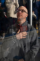 KELOWNA, CANADA - MARCH 2:  Portland Winterhawks' athletic therapist Rich Campbell stands on the bench during the national anthem against the Kelowna Rockets on March 2, 2019 at Prospera Place in Kelowna, British Columbia, Canada.  (Photo by Marissa Baecker/Shoot the Breeze)