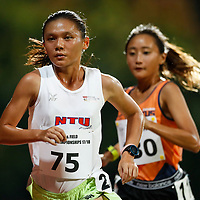 Nicole Low (left) of Nanyang Technological University overtakes Vanessa Lee of National University of Singapore with six laps remaining during the women's 5000m event. (Photo © Lim Yong Teck/Red Sports) The 2018 Institute-Varsity-Polytechnic Track and Field Championships were held over three days in January.<br /> <br /> Story: https://www.redsports.sg/2018/01/15/ivp-day-one/<br /> <br /> Story: https://www.redsports.sg/2018/01/18/ivp-day-two/<br /> <br /> Story: https://www.redsports.sg/2018/01/23/ivp-day-three/