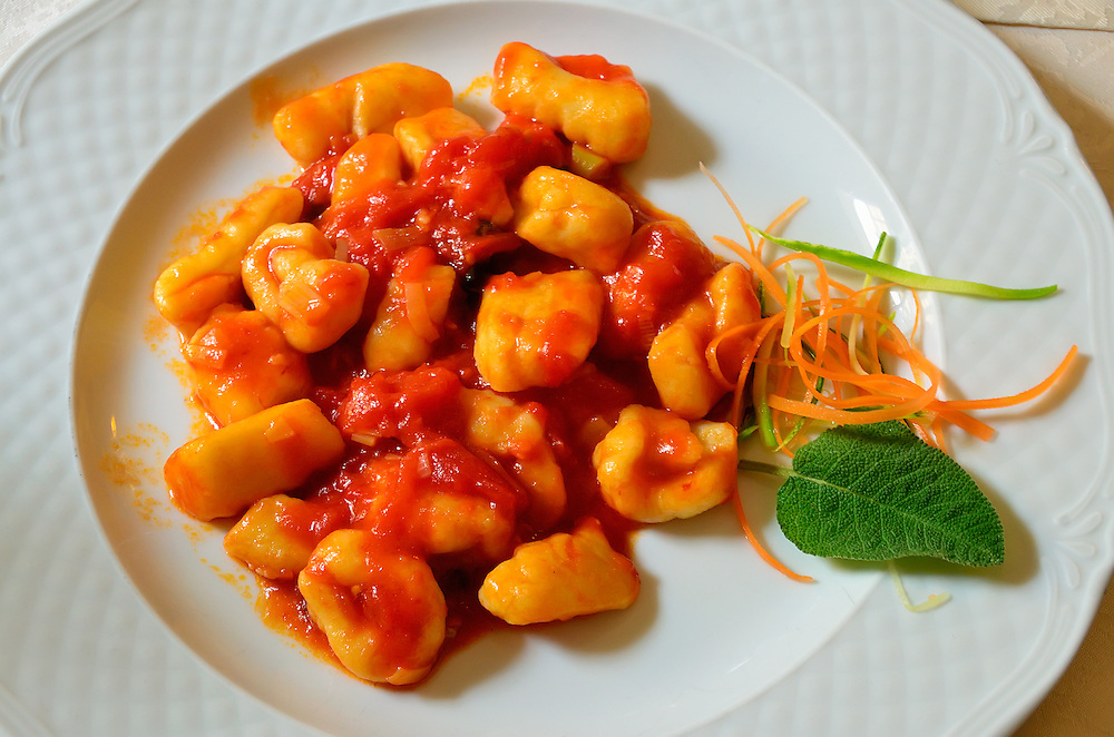 A plate of freshly made gnocchi at a restaurant in Tuscany, Italy.