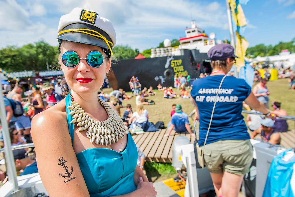 The Greenpeace area - a campaigner on board their own fishing vessel, the Rising Tide,  after its election tour around England and Wales gaining support from parliamentary candidates for a higher catch quota to make fishing viaable for small fishermen. The 2015 Glastonbury Festival, Worthy Farm, Glastonbury.