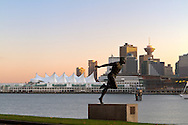 The Harry Jerome statue and one view of downtown Vancouver from Stanley Park.  The large yacht on the right was docked at the Chevron marine fuel station in Coal Harbour.  Photographed from Stanley Park Drive in Vancouver, British Columbia, Canada.