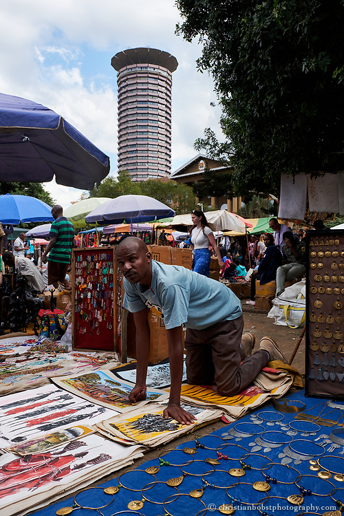 Massai market at Yaya Centre. The market takes place on different locations in the city on different weekdays, on Sundays at the Yaya center. The Kenyattta International Conference Centre in the background is one of the highest buldings in Nairobi and offers a nice view over the city from the top.