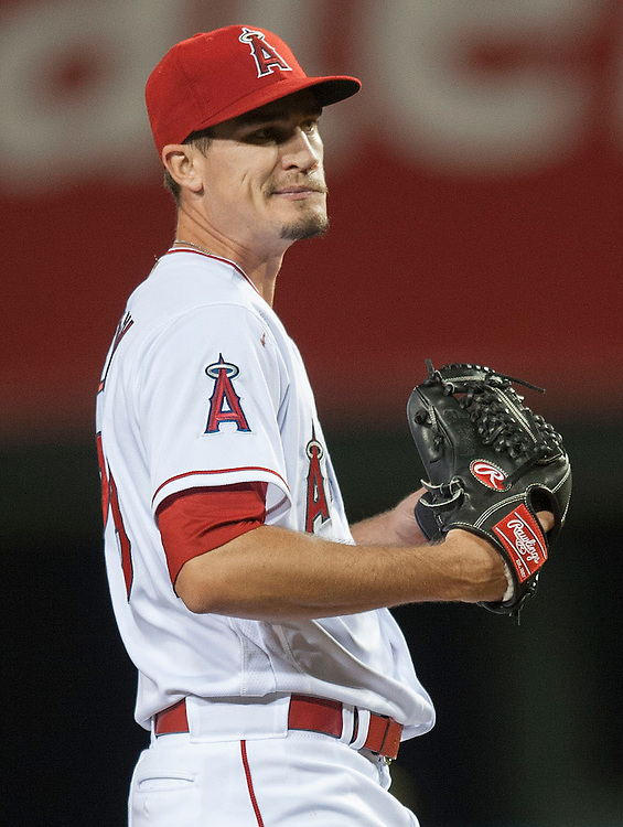 Angels starting pitcher Andrew Heaney grimaces during a four-run third inning by the Chicago Cubs during their game at Angel Stadium Tuesday.