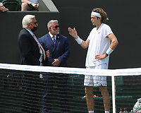 Tennis - 2021 All England Championships - Week One - Day Five (Friday) - Wimbledon<br /> Fabio Fognini v Andre Rublev<br /> <br /> Andre Rublev complains to the referee while Fognini gets treatment<br /> <br /> CreditCOLORSPORT/Andrew Cowie