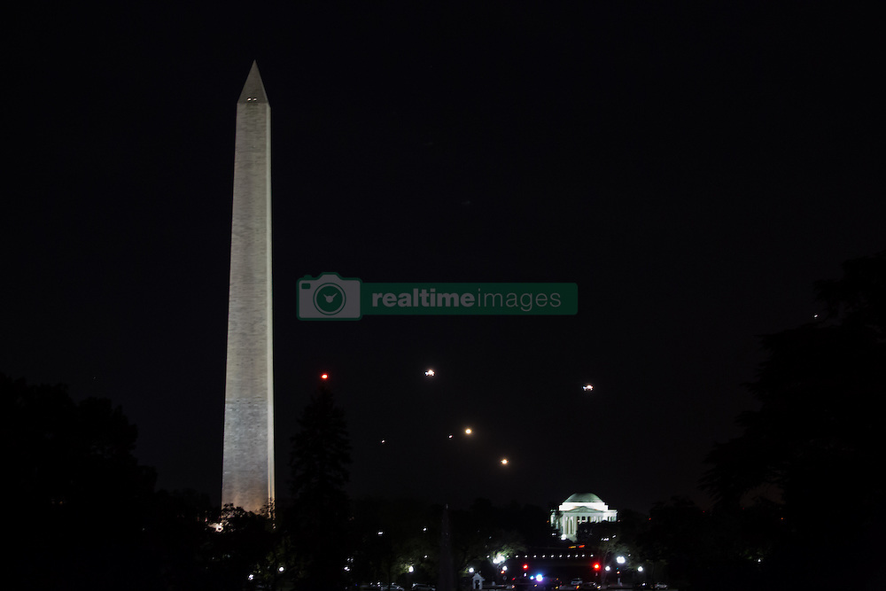 October 11, 2016 - Washington, DC, United States - A nighttime view of the Washington Monument, and the Jefferson Memorial from the South Lawn of the White House October 11, 2106 in Washington, DC. (Credit Image: © Cheriss May/NurPhoto via ZUMA Press)