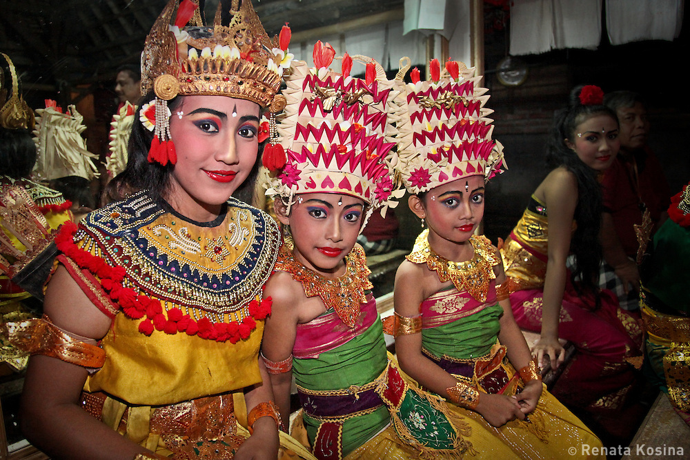 Young girls in Batubulan village, Bali wait backstage for their turn to perform in Kecak dance. Kecak is the most unique Balinese dance in which, instead of music, 100 men chant Cak. In the 1930s Ramayana story was added to the original trance dance.