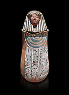Ancient Egyptian Human headed canopic jar for Amenemheb, clay, New Kingdom, 19th Dynasty (1292-1190 BC), Deir el-Medina. Egyptian Museum, Turin. Old Fund cat 3471. Black background<br /> <br /> The canopic jars were four in number, each for the safekeeping of particular human organs: the stomach, intestines, lungs, and liver, all of which, it was believed, would be needed in the afterlife. By the First Intermediate Period jars with human heads (assumed to represent the dead) began to appear .<br /> <br /> If you prefer to buy from our ALAMY PHOTO LIBRARY  Collection visit : https://www.alamy.com/portfolio/paul-williams-funkystock/ancient-egyptian-art-artefacts.html  . Type -   Turin   - into the LOWER SEARCH WITHIN GALLERY box. Refine search by adding background colour, subject etc<br /> <br /> Visit our ANCIENT WORLD PHOTO COLLECTIONS for more photos to download or buy as wall art prints https://funkystock.photoshelter.com/gallery-collection/Ancient-World-Art-Antiquities-Historic-Sites-Pictures-Images-of/C00006u26yqSkDOM