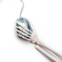 skeleton hand with a computer mouse