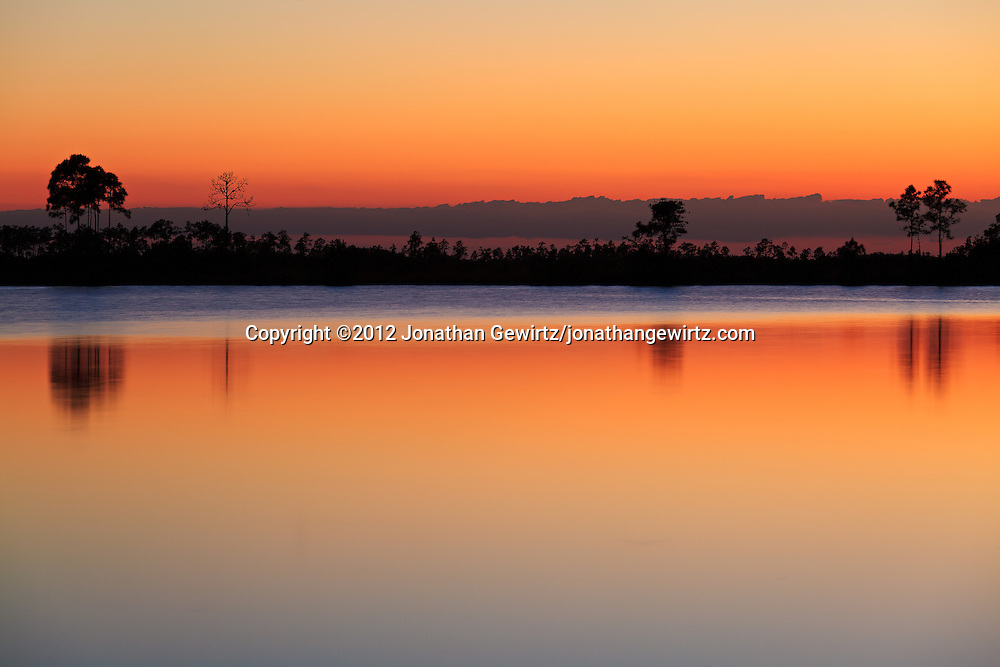 A colorful sky reflects from the surface of Pine Glades Lake in Everglades National Park, Florida shortly after sunset. WATERMARKS WILL NOT APPEAR ON PRINTS OR LICENSED IMAGES.