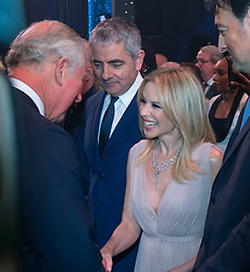 Embargoed to 0001 Tuesday November 13 The Prince of Wales meeting Kylie Minogue after the We Are Most Amused and Amazed performance at the London Palladium.