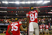 Chris Worley #35 and Corey Smith #84 of the Ohio State Buckeyes celebrate after defeating the Oregon Ducks during the College Football Playoff National Championship Game at AT&T Stadium on January 12, 2015 in Arlington, Texas.  (Cooper Neill for The New York Times)