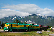 White Pass & Yukon Route railway station in Skagway, Alaska, USA. Skagway was founded in 1897 on the Alaska Panhandle. Skagway's population of about 1150 people doubles in the summer tourist season to manage more than one million visitors per year. Half of Alaska's total visitors come via cruise ships. Klondike Gold Rush National Historical Park commemorates the late 1890s Gold Rush with three units in Municipality of Skagway Borough: Historic Skagway; the White Pass Trail; and Dyea Townsite and Chilkoot Trail. (A fourth unit is in Pioneer Square National Historic District in Seattle, Washington.)