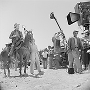 Y-510725G-04 (production shot. Jimmy Stewart on horse, a mirror is raised so he can see his face. technicolor camera)  July 25, 1951