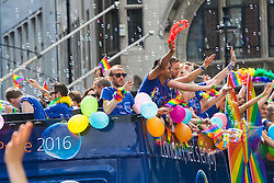 Portland Place, London, June 25th 2016. Thousands of LGBT people and their supporters gather for Pride in London, a colourful celebration of the hard-won rights of lesbian, gay, bisexual and transgender  people. PICTURED: Bubbles sparkle in the sun as revellers wave to the crowd.