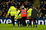 Burton Albion striker Luke Varney (19) is taken to hospital on a spinal board after a collision with Watford goalkeeper Costel Pantilimon (30) during the The FA Cup 3rd round match between Watford and Burton Albion at Vicarage Road, Watford, England on 7 January 2017. Photo by Richard Holmes.