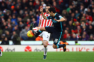 Geoff Cameron of Stoke City is tackled by Jesus Navas of Manchester City. Barclays Premier league match, Stoke city v Manchester city at the Britannia Stadium in Stoke on Trent, Staffs on Saturday 5th December 2015.<br /> pic by Chris Stading, Andrew Orchard sports photography.