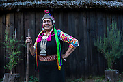 Juana Calfunao Paillalef,  a female Lonko and certainly one of the most outspoken defenders of the Mapuche cause stands in front of her Ruka,  the traditional circular wood and straw hut on her ancestral land. Having being inprisoned several times and in all for more then four years, has become an important symbol for the resistance of her indigenous people. She is internationally known and admired both at home and abroad, though her many enemies inside the Chilean state consider her to be a terrorist. She and her family are constantly threatened  and intimidated by the police. They have suffered multpile physical and verbal aggressions over the years as well and continually be under surveillance. Unbowed she continues her resisitance fight, Araucania, Chile. February 14, 2018.
