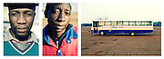 """Two boys pose as they start working in the morning at the bus station of Irene, Johannesburg.<br /> <br /> """"Where we live, where we leave"""".<br /> Faces and places in Johannesburg.<br /> South Africa, 2010."""