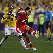 Issey Nakajima-Farran, Canada, in action during the Columbia Vs Canada friendly international football match at Red Bull Arena, Harrison, New Jersey. USA. 14th October 2014. Photo Tim Clayton