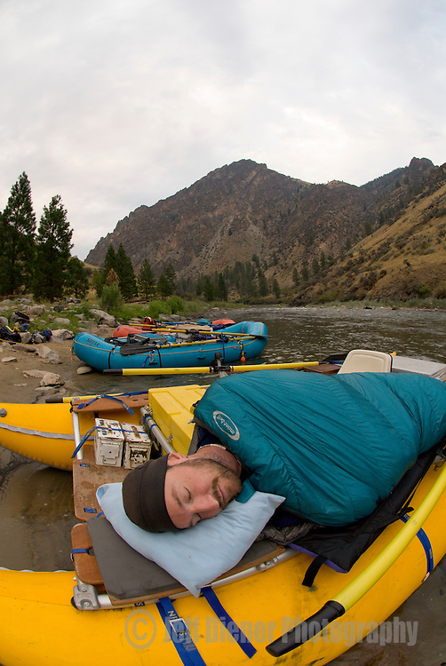 A rafter sleeps on the raft along the Middle Fork of the Salmon River.  Frank Church-River of No Return Wilderness, Idaho.