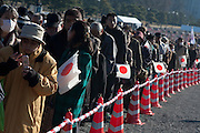 Well-wishers carry Japanese flags as they enter the Imperial Palace. Emperor Akihito 76th birthday was celebrated in Japan with a national holiday and thousands of well-wishers being allowed into the Royal Palace for the occasion. He made three appearances during the day and spoke of the economy difficulties many Japanese people are suffering during his address. He was accompanied by Empress Michiko, Crown Prince Naruhito, Prince Akishino and their wives. Tokyo, Japan December 23rd 2009