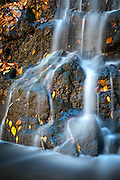 The Cascade Falls in Patapsco Valley State Park near Oella, Maryland. Shot in fall with colorful leaves and a time exposure.
