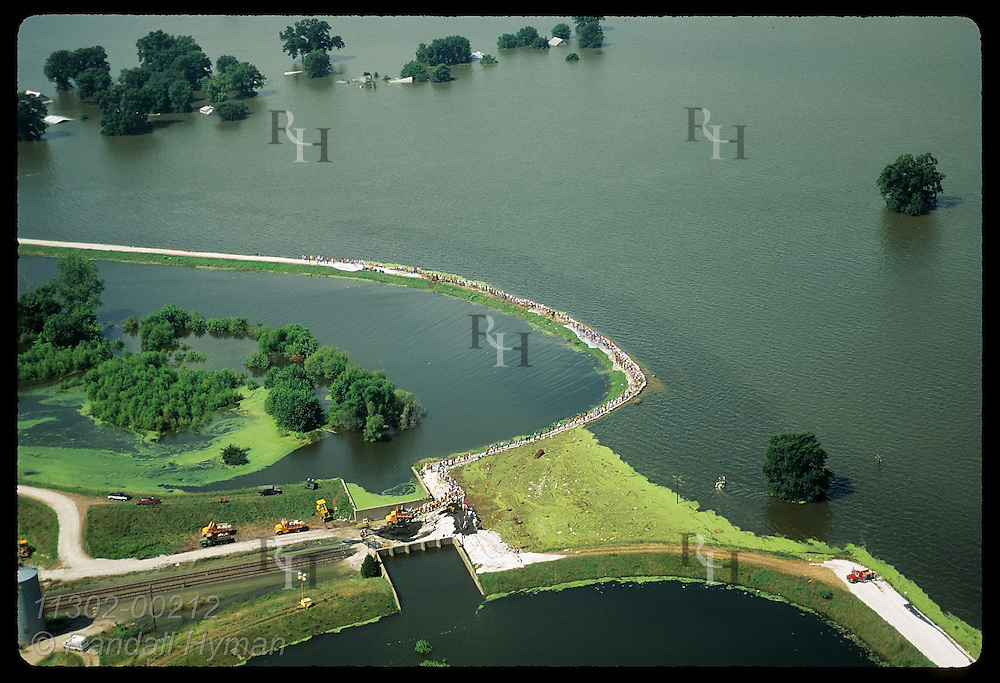 Aerial:sandbaggrs on levee of state's oldest town on 8/4/93 fight Mississippi; Prairie du Rocher. Illinois