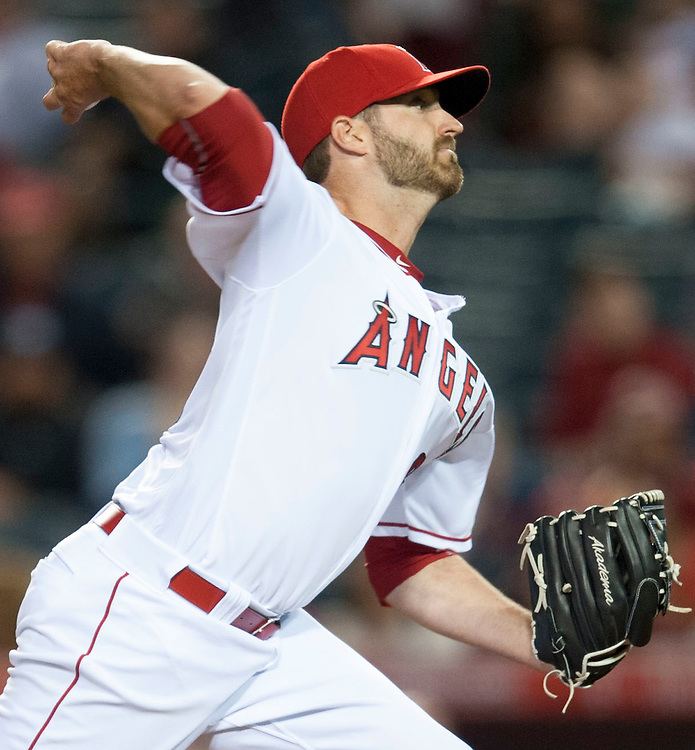 The Angels' A.J. Achter pitches in the eighth inning against the Minnesota Twins Monday at Angel Stadium.<br /> <br /> ///ADDITIONAL INFO:   <br /> <br /> angels.0614.kjs  ---  Photo by KEVIN SULLIVAN / Orange County Register  -- 6/13/16<br /> <br /> The Los Angeles Angels take on the Minnesota Twins Monday at Angel Stadium.