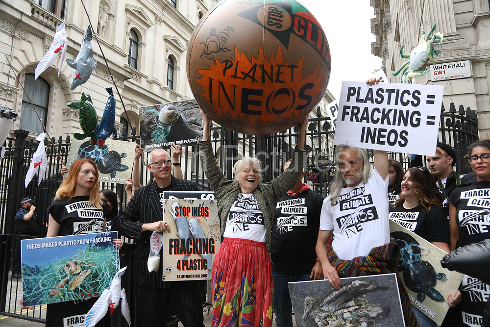 Dame Vivienne Westwood and son Joe Corre from Talk Fracking bring 'armagedddon' to to Downing Street June 5th 2018, Central London, United Kingdom. The  protest is  against the petro chemical company INEOS' license to frack. They say 'Planet Ineos will destroy us all in quest to frack for plasctic'. INEOS produces plasctic and is currently using imported gas to the production and much of the gas they will be fracking may be used in the plastic industry.