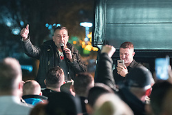 "© Licensed to London News Pictures . 03/11/2017 . Manchester , UK . LUTZ BACHMANN , founder of the PEGIDA movement and TOMMY ROBINSON (real name Stephen Yaxley-Lennon ) speaking to supporters at the launch of the former EDL leader's book "" Mohammed's Koran "" at Castlefield Bowl . Originally planned as a ticket-only event at Bowlers Exhibition Centre , the launch was moved at short notice to a public location in the city . Photo credit : Joel Goodman/LNP"