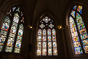 Stained glass windows of Saint Corentin Cathedral on 24th September 2021 in Quimper, Brittany, France. Gothic cathedral, begun in 1239, with soaring twin spires & 15th-century stained-glass windows. Quimper is the ancient capital of Cornouaille, Brittany's most traditional region, and has a distinctive Breton Celtic character. Its name is the Breton word Kemper, meaning confluence. Brittany is a peninsula, historical county, and cultural area in the west of France, covering the western part of what was known as Armorica during the period of Roman occupation. It became an independent kingdom and then a duchy before being united with the Kingdom of France in 1532 as a province governed as a separate nation under the crown.