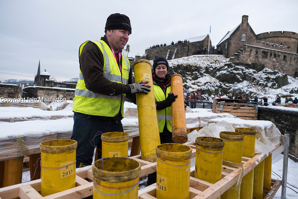 Edinburgh, Scotland, United Kingdom. 29 December, 2017. Pyrotechnicians from Titanium Fireworks demonstrate large fireworks and launching tubes at Edinburgh Castle ahead of the annual Hogmanay fireworks display on New Years Eve. Here 150mm launching tubes are handled by Lynn Wiseman and Shaun Gibson. These are the largest shells used in the display.