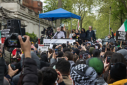 London, UK. 15th May, 2021. Former Labour Party leader Jeremy Corbyn addresses tens of thousands of people protesting outside the Israeli embassy on Nakba Day following the March for Palestine. The march, which was organised by Palestine Solidarity Campaign (PSC), CND, Friends of Al Aqsa, Muslim Association of Britain, Palestinian Forum in Britain and Stop The War Coalition, took place in protest against Israeli air raids on Gaza, the deployment of Israeli forces to the Al-Aqsa mosque during Ramadan and attempts to forcibly displace Palestinian families from the Sheikh Jarrah neighbourhood of East Jerusalem and speakers called for an end to Israeli support for and arms sales to Israel.
