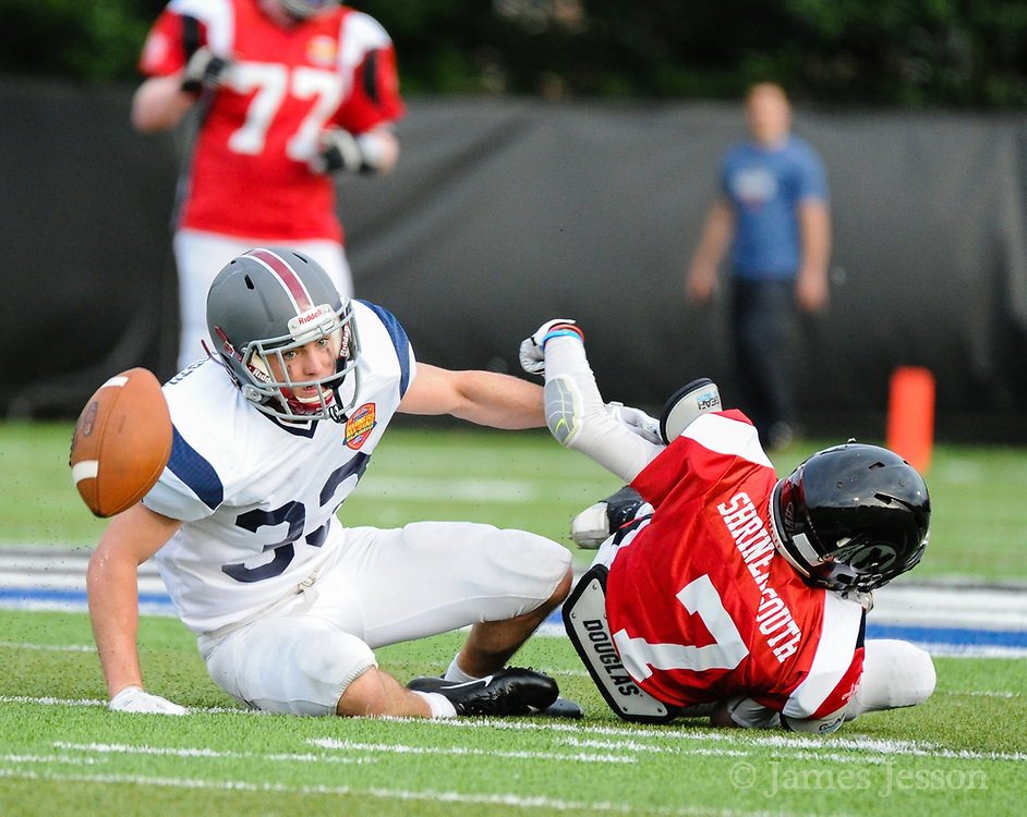 North Squad's Cully Curran, from Arlington High School, takes down South Squad's Colin O'Brien, from Middleboro High School, during the Shriner's All-Star Football Classic at Bentley University in Waltham, June 22, 2018.   [Wicked Local Photo/James Jesson]