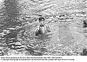 Julian Alison drinking in the river. May morning Oxford.1 May 1983. Film 83234f17<br />© Copyright Photograph by Dafydd Jones<br />66 Stockwell Park Rd. London SW9 0DA<br />Tel 0171 733 0108