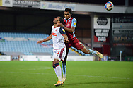 Scunthorpe United Jacob Bedeau (4) Bolton Wanderers Nathan Delfouneso (7) battles for possession during the EFL Sky Bet League 2 match between Scunthorpe United and Bolton Wanderers at the Sands Venue Stadium, Scunthorpe, England on 24 November 2020.