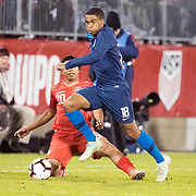 EAST HARTFORD, CONNECTICUT- October 16th:  Reggie Cannon #18 of the United States challenged by Edison Flores #20 of Peru during the United States Vs Peru International Friendly soccer match at Pratt & Whitney Stadium, Rentschler Field on October 16th 2018 in East Hartford, Connecticut. (Photo by Tim Clayton/Corbis via Getty Images)